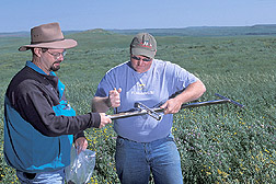 Research associate and ARS physical science technician take soil samples from rangeland: Click here for full photo caption.