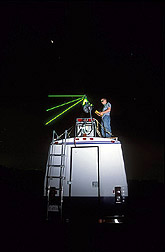 Photo: Michael Cloos, a University of Iowa student, adjusts the LiDAR laser. Link to photo information