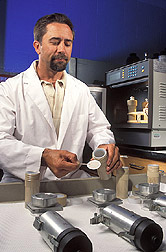 Technician prepares particulate-filter samples: Click here for full photo caption.