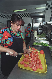 Food service workers prepare meals for the school lunch program: Click here for full photo caption.
