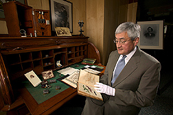 National Agricultural Library director examines items in NAL's special collection of Riley artifacts: Click here for full photo caption.