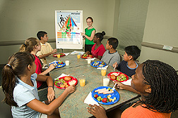 Dietitian shares nutrition information with middle-school students: Click here for full photo caption.