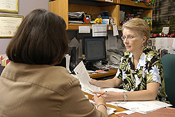 A behavioral nutritionist reviews intervention materials with staff: Click here for full photo caption.