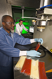 Food microbiologist and engineer evaluate effects of high-pressure processing on microbial stability of tomato juice and liquid eggs: Click here for full photo caption.