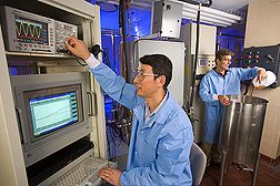 Howard Zhang and chemical engineer David Geveke operate lab equipment used for testing pulsed electric field and radio-frequency electric field treatments. Link to photo information