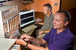 Using gas chromatography and mass spectrometry, plant physiologist (left) and technician analyze volatile apple compounds that contribute to both aroma and flavor: Click here for full photo caption.