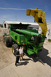 Soil scientist (left) discusses commercial combine modifications: Click here for full photo caption.
