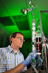 Chemist performs a lab-scale distillation of ethanol from a fermentation broth: Click here for full photo caption.