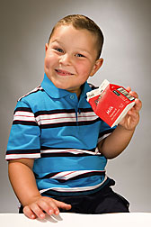 Photo: Young boy holding a carton of milk. Link to photo information