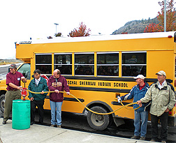 A biodiesel blend containing oil from winter canola is pumped into a Paschal Sherman Indian School bus: Click here for full photo caption.
