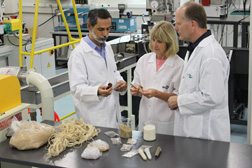 In Brazil, ARS plant physiologist Greg Glenn (right) and ARS botanist De Wood (center) inspect composite materials that contain plant fiber with Luiz Mattoso, director of the EMBRAPA Agricultural Instrumentation Center in Sao Carlos: Click here for full photo caption.