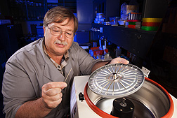 Technician Mike Judy loads immunoglobulin immunocrit tubes into a centrifuge: Click here for full photo caption.