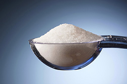 Photo:  A measuring spoon holding salt. Link to photo information
