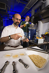 Biochemical engineer Bruce Dien and microbiologist Loren Iten use mini-batch reactors to pretreat biomass at high temperatures to prepare it for fermentation to ethanol.