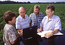 Scientist discuss data from farmer's field
