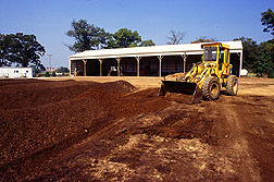 Photo: Composting facility with front end loader. Link to photo information