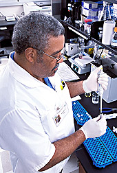 Chemist mixes a rice extract with a reagent: Click here for full photo caption.