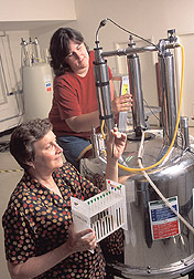 Scientist Sara Wright (foreground) and technician examine molecular structure of soil organic matter:  Link to photo information