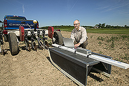 Technician begins a geophysical data collection sequence: Click here for full photo caption.