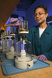 Summer intern from Wilberforce University uses a suction filtration apparatus: Click here for full photo caption.