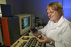 Technician uses near-infrared spectroscopy: Click here for full photo caption.