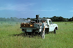 ARS researcher operates experimental truck-mounted ultra-low-volume equipment: Click here for full photo caption.