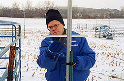 Agroecologist changes ammonia tubes on a cold winter's day: Click here for full photo caption.