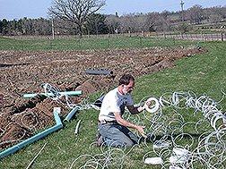 Soil scientist installs drainage lysimeters: Click here for full photo caption.