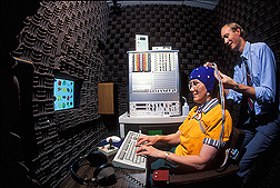 Psychologist performs an electroencephalogram (EEG), which measures responses from a volunteer's brain during a dietary study: Click here for full photo caption.