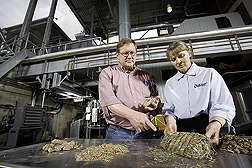 At the University of Minnesota-Morris Biomass Gasification Facility, gasification researcher and ARS soil scientist evaluate potential biomass feedstocks, including pressed corn stover for use in an institutional-scale unit: Click here for full photo caption.