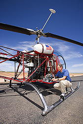 Before takeoff, physical scientist prepares camera equipment for airborne multispectral imaging: Click here for full photo caption.