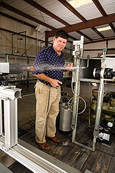 Photo: ARS agricultural engineer Clint Hoffmann evaluates a pesticide spray nozzle.  Link to photo information