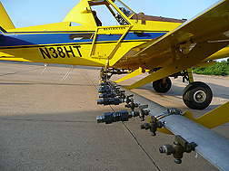 An aircraft fitted with Bete NF70 nozzles, which were shown in the lab to produce the optimum droplet size for oil dispersants: Click here for full photo caption.