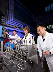 Photo: Three researchers examine a more heat tolerant plastic made from corn. Link to photo information