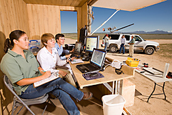 In Las Cruces, New Mexico, researchers prepare to launch an unmanned aerial vehicle from a catapult (atop the vehicle): Click here for full photo caption.