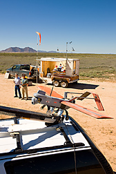 A team of scientists prepares to launch an unmanned aerial vehicle from a catapult: Click here for full photo caption.