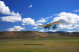 Pilot Joe Nance of Cloud Street Aerial Services, Fort Collins, CO, flies a light sport airplane at 300 feet above ground level as part of a 2008 aerial survey of streamside vegetation in Northeast Nevada: Click here for full photo caption.