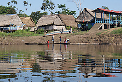 A village on the bank of Rio Pastaza, in Peru: Click here for full photo caption.