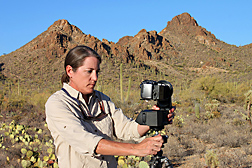 Using a high-resolution digital camera in the Tucson Mountains, ARS hydraulic engineer Mary Nichols obtains a series of photographs that can be put together to create a panorama: Click here for full photo caption.
