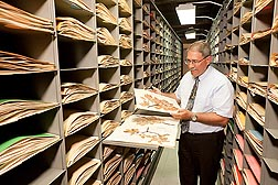 ARS Deputy Assistant Administrator Robert Griesbach takes a look at one of the many plant specimens inside the herbarium at the Arboretum: Click here for full photo caption.