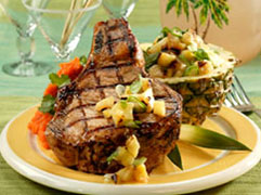 Grilled pork chop with tropical fruit salsa.