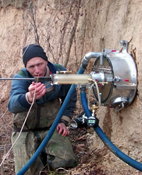 Photo: ARS hydraulic engineer Gregory J. Hanson using the Jet Test apparatus in the field.