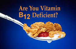Heaping spoonful of breakfast cereal flakes along with milk and piece of fresh strawberry, with text: 'Are You Vitamin B12 Deficient?' Link to photo information