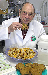 George Inglett tastes products--cookies, trail mix and green-tea chocolate--made with C-trim.