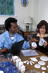 Nutritionist, left, helps a study participant recall food portions. Link to photo information