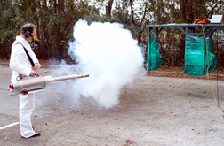 Person demonstrates use of thermal fogger.
