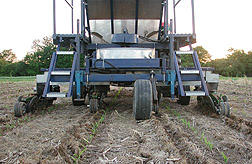 Photo: A new machine that buries poultry litter in shallow trenches in fields to provide fertilizer but control runoff of excess nutrients. Link to photo information