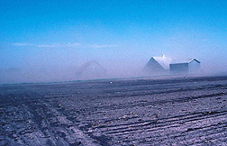 Photo: Dust blowing in the wind on a farm in Iowa.