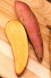 Photo: Halved and whole sweetpotatoes. Link to photo information
