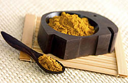 Photo: Powdered turmeric in a small dish and on a spoon.